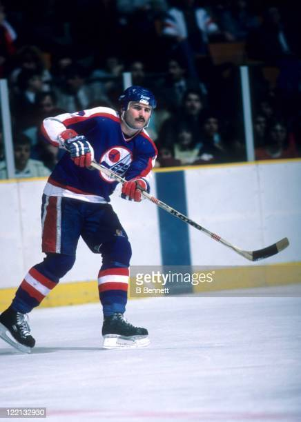 Tim Watters of the Winnipeg Jets passes the puck during an NHL game against the New Jersey Devils on March 12 1985 at the Brendan Byrne Arena in East...