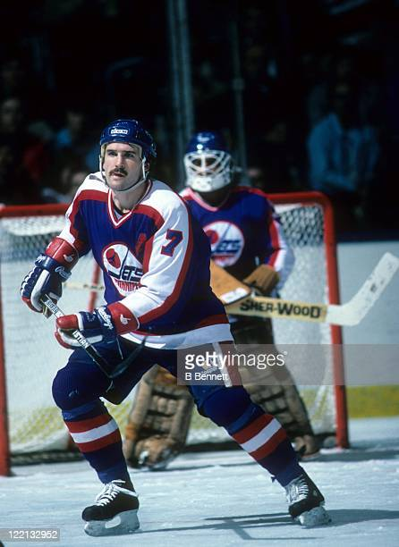 Tim Watters of the Winnipeg Jets skates on the ice during an NHL game in November 1986