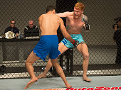 Tim Welch punches Jason Gonzalez during the elimination fights at the UFC TUF Gym on July 17 2015 in Las Vegas Nevada