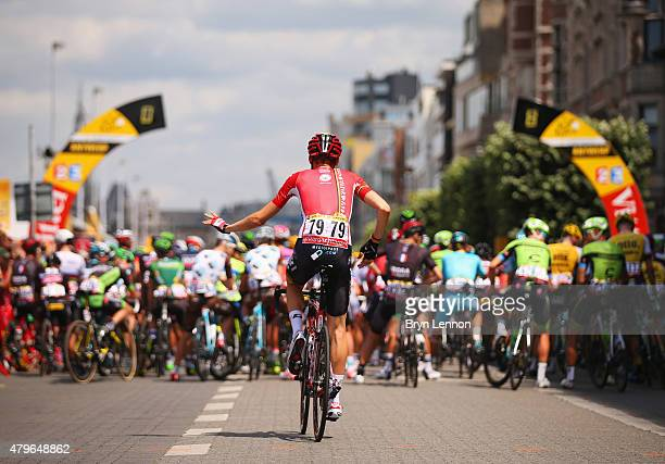 Tim Wellens of Belgium and LottoSoudal joins fellow riders as they line up ahead of the start of stage three of the 2015 Tour de France a 1595 km...