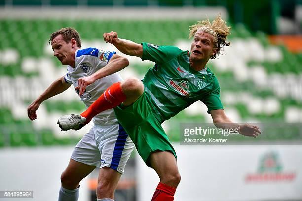 Tim Wendel of Sportfreunde Lotte and Jesper Verlaat of Werder Bremen II compete for the ball during Werder Bremen II vs Sportfreunde Lotte 3...