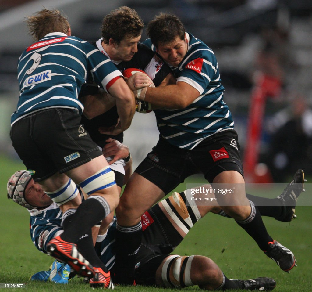 Tim Whithead tackled by 2 Griquas players during the Absa Currie Cup match between The Sharks and GWK Griquas at Mr Price KINGS PARK on October 12, 2012 in Durban, South Africa.