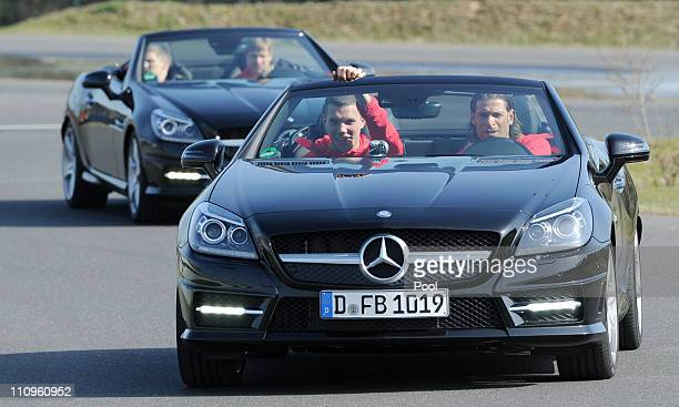 Tim Wiese and Lukas Podolski of team Germany attend a German national team safe driving training lesson of general sponsor MercedesBenz in a SLK 350...