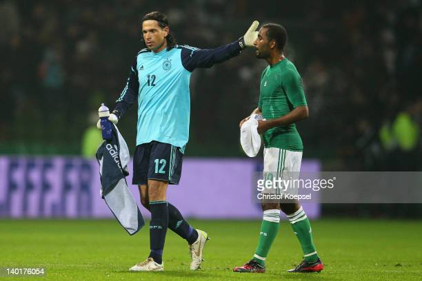 Tim Wiese comforst Cacau of Germany after losing 12 the International friendly match between Germany and France at Weser Stadium on February 29 2012...