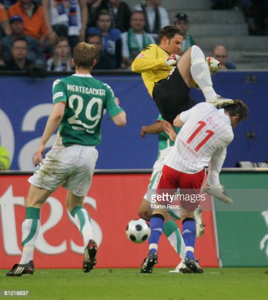 Tim Wiese goalkeeper of Bremen attacks Ivica Olic of Hamburg during the Bundesliga match between Hamburger SV and Werder Bremen at the HSH Nordbank...