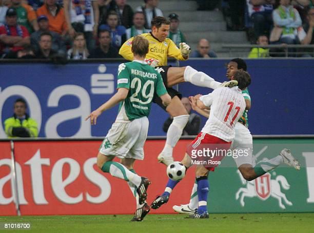 Tim Wiese goalkeeper of Bremen attacks Ivica Olic of Hamburg during the Bundesliga match between Hamburger SV and Werder Bremen at the HSH Nordbank...