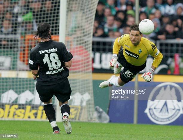 Tim Wiese goalkeeper of Bremen saves the ball during the Bundesliga match between Werder Bremen and Eintracht Frankfurt at the Weserstadion on May 12...
