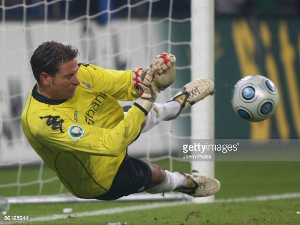 Tim Wiese of Bremen saves a penalty during the DFB Cup Semi Final match between Hamburger SV and SV Werder Bremen at the HSH Nordbank Arena on April...