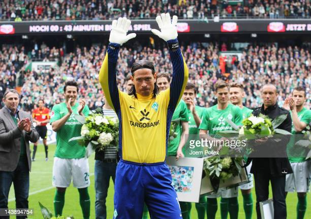 Tim Wiese of Bremen says farewell to the fans prior to the Bundesliga match between SV Werder Bremen and FC Schalke 04 at Weser Stadium on May 5 2012...