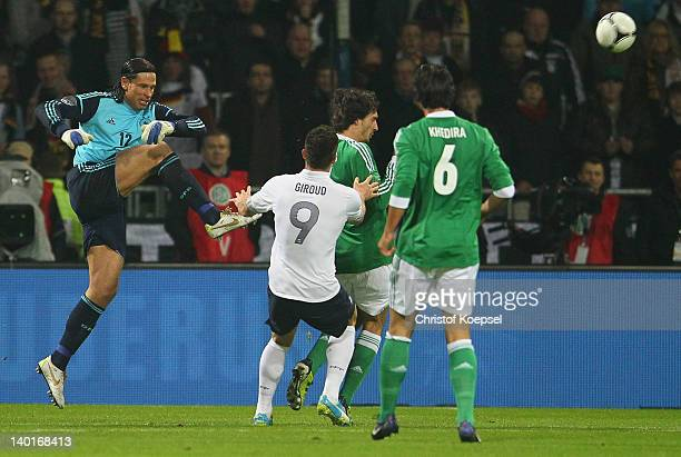 Tim Wiese of Germany saves a ball against Olivier Girou of France during the International friendly match between Germany and France at Weser Stadium...