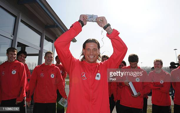 Tim Wiese of team Germany celebrates after winning a driving competition during the German national team safe driving training lesson of general...