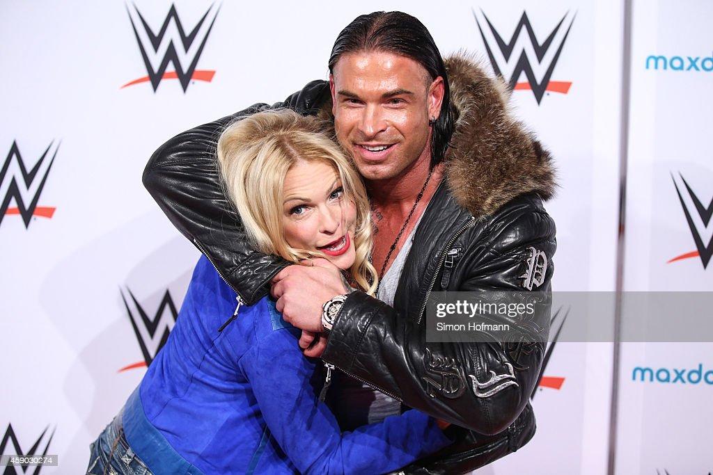 Tim Wiese poses with Sonya Kraus (R) prior to WWE Live 2014 at Festhalle on November 15, 2014 in Frankfurt am Main, Germany.