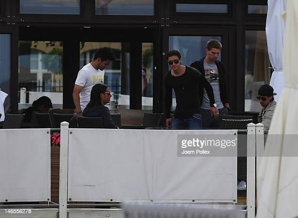 Tim Wiese Sami Khedira Mesut Oezil Ilkay Guendogan and RonRobert Zieler of th German national team are sighted in a beachbar at the beach on June 19...