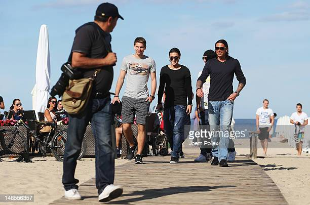 Tim Wiese Sami Khedira Mesut Oezil Ilkay Guendogan and RonRobert Zieler of the German national team are sighted at a beachbar at the beach on June 19...