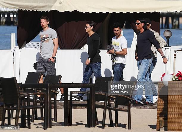 Tim Wiese Sami Khedira Mesut Oezil Ilkay Guendogan and RonRobert Zieler of the German national team are sighted in a beachbar at the beach on June 19...