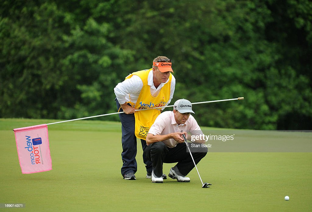 Tim Wilkinson of New Zealand studies his putt on the third hole during the third round of the BMW Charity Pro-Am Presented by SYNNEX Corporation at the Thornblade Club on May 18, 2013 in Greer, South Carolina.