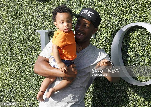 Tim Witherspoon and his son Titan Jewell Witherspoon attend Serena Williams' match on day seven of the 2015 US Open at USTA Billie Jean King National...