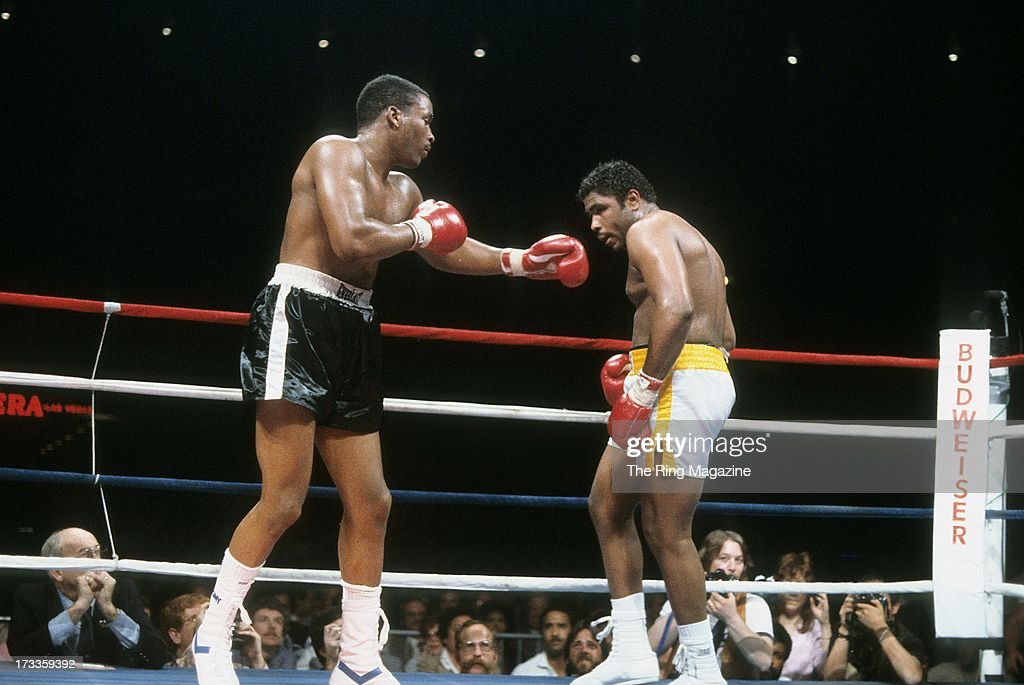 Tim Witherspoon (L) throws a punch against <a gi-track='captionPersonalityLinkClicked' href=/galleries/search?phrase=Greg+Page&family=editorial&specificpeople=730956 ng-click='$event.stopPropagation()'>Greg Page</a> during the fight at Convention Center in Las Vegas, Nevada. Tim Witherspoon won the vacant WBC heavyweight title by a MD 12.