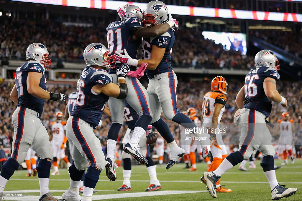 Tim Wright #81 of the New England Patriots celebrates with Bryan Stork #66 after scoring a touchdown during the first quarter against the Cincinnati Bengals at Gillette Stadium on October 5, 2014 in Foxboro, Massachusetts.