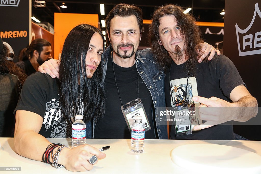 Tim Young, drumemr Johnny Tempesta and drummer Paul Bostaph attend the 2013 NAMM show at Anaheim Convention Center on January 25, 2013 in Anaheim, California.