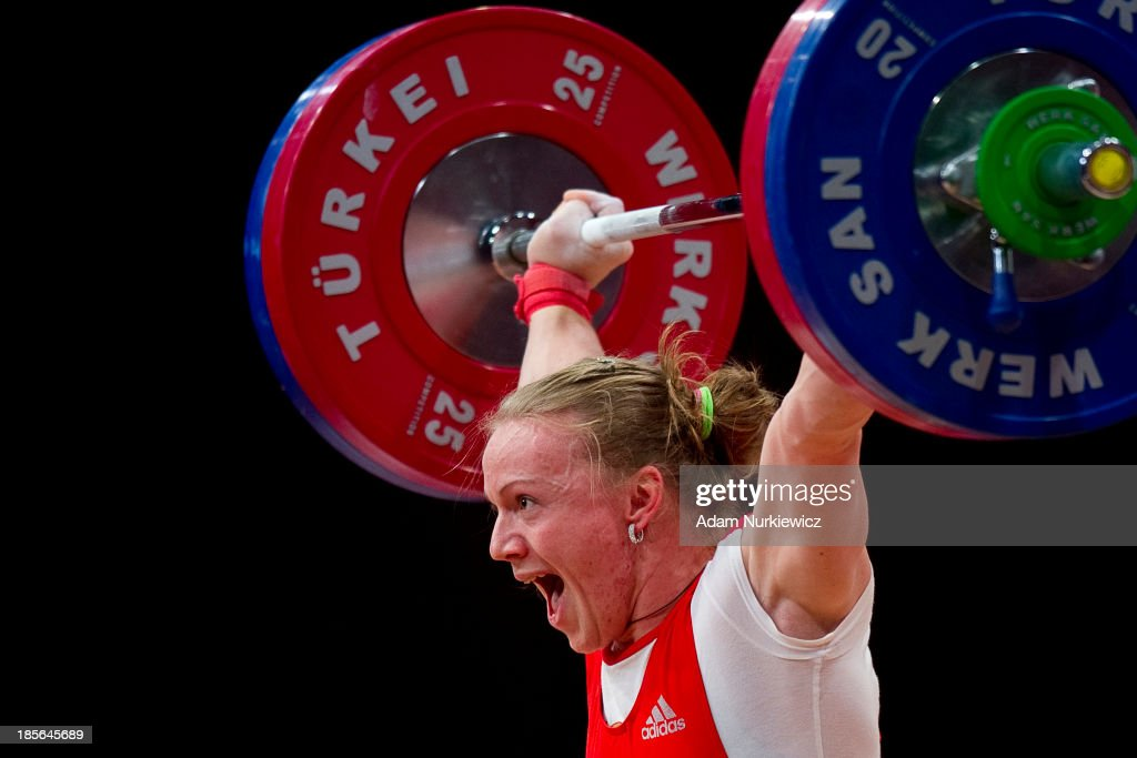 Tima Turieva from Russia lifts in Snatch competition woman's 63 kg Group A during weightlifting IWF World Championships Wroclaw 2013 at Centennial Hall in Wroclaw on October 23, 2013