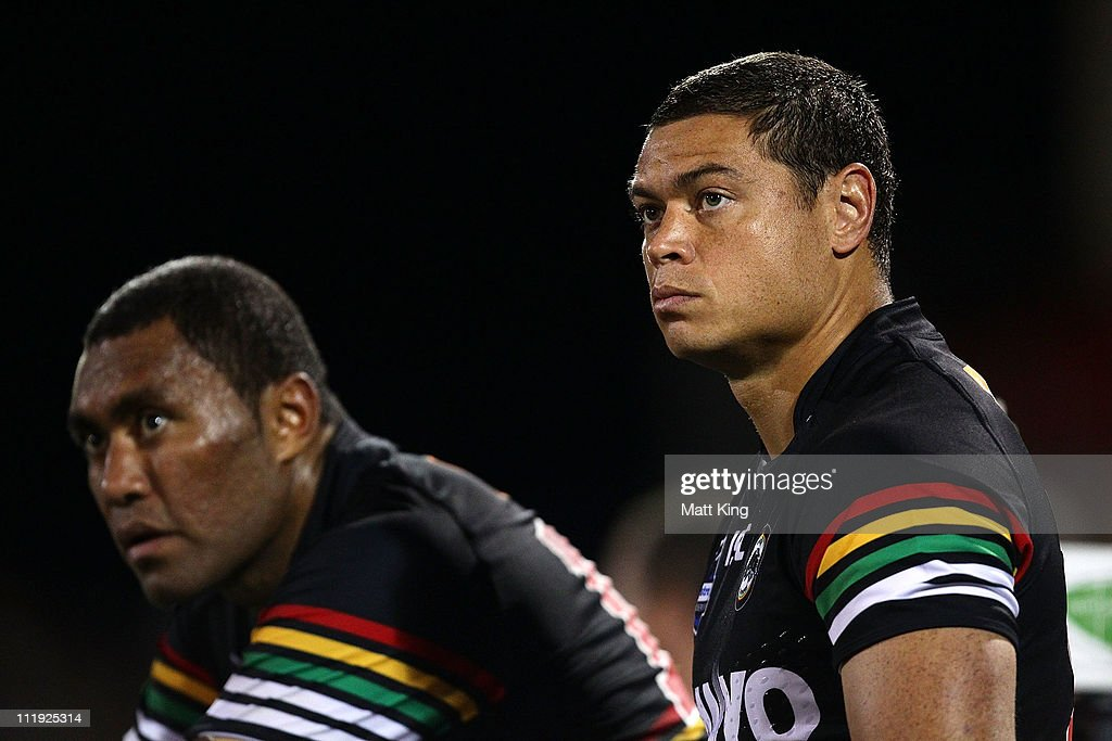 Timana Tahu (R) and Petero Civoniceva (L) of the Panthers wait on the bench during the round five NRL match between the Penrith Panthers and the Canberra Raiders at Centrebet Stadium on April 9, 2011 in Sydney, Australia.