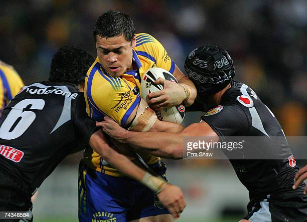 Timana Tahu of the Eels is tackled by the Warriors defence during the round 11 NRL match between the Parramatta Eels and the Warriors at Parramatta...