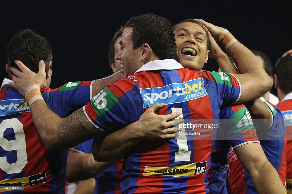 Timana Tahu of the Knights celebrates with his team mates after scoring a try during the round 16 NRL match between the Newcastle Knights and the Wests Tigers at Hunter Stadium on June 25, 2012 in Newcastle, Australia.