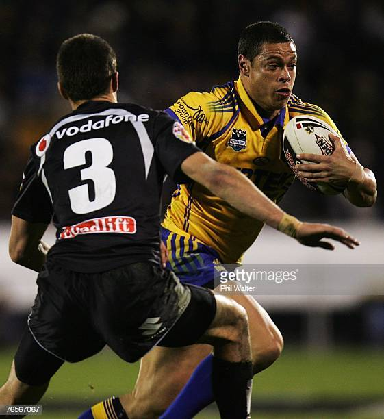 Timana Tahu of the Parramatta Eels fends off Todd Byrne of the Warriors during the NRL qualifying final match between the Warriors and the Parramatta...