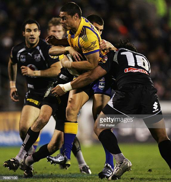 Timana Tahu of the Parramatta Eels is tackled by George Gatis of the Warriors during the NRL qualifying final match between the Warriors and the...