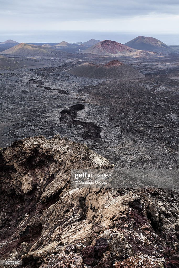 Timanfaya National Park as seen from a volcano : Stock Photo