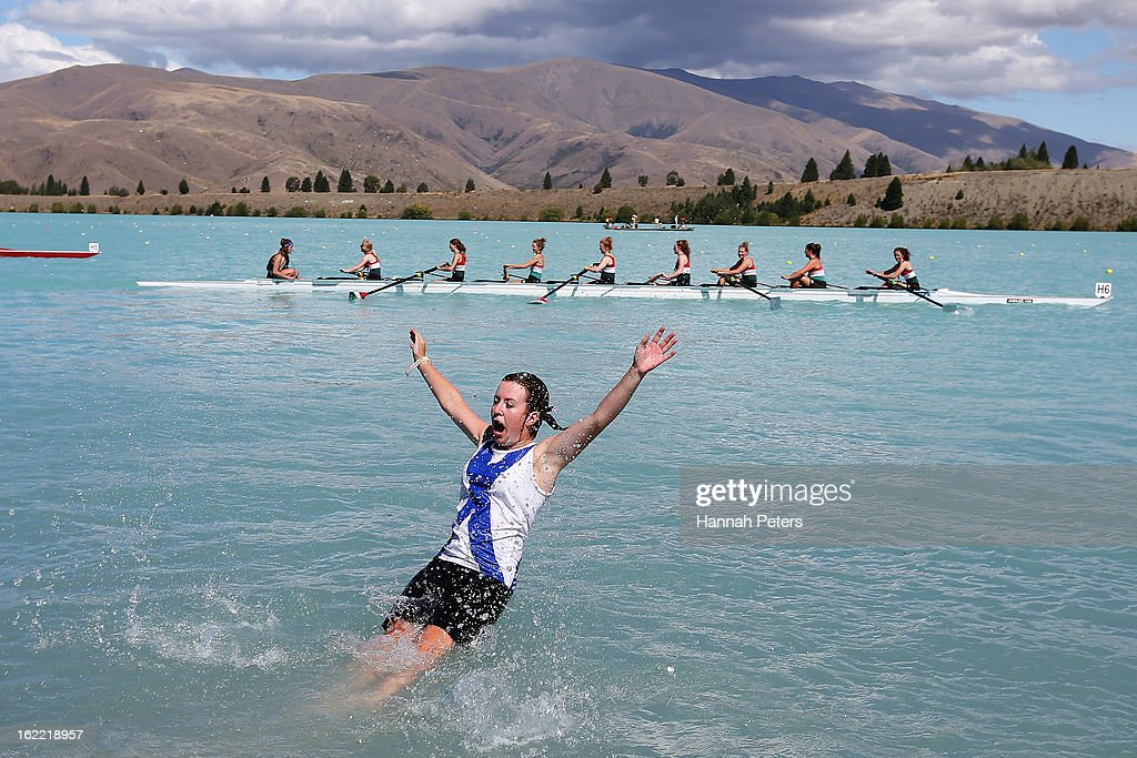 Timaru cox Zoe Dobbs is thrown into the water after winning the Women's Club 8+ final during day three of the New Zealand Rowing Championships at Lake Ruataniwha on February 21, 2013 in Wellington, New Zealand.