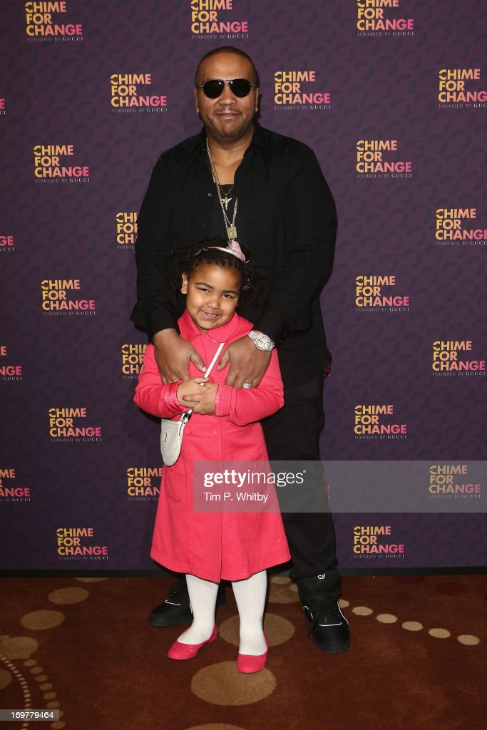Timbaland and daughter pose backstage in the media room at the 'Chime For Change: The Sound Of Change Live' Concert at Twickenham Stadium on June 1, 2013 in London, England. Chime For Change is a global campaign for girls' and women's empowerment founded by Gucci with a founding committee comprised of Gucci Creative Director Frida Giannini, Salma Hayek Pinault and Beyonce Knowles-Carter.
