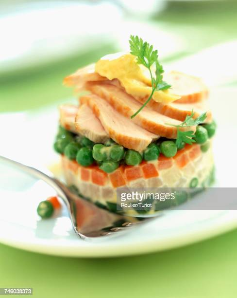 Timbale of mixed vegetables and thinly sliced chicken