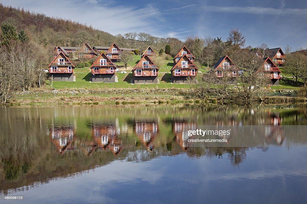 Timber Holiday Lodges By a Lake : Stock Photo