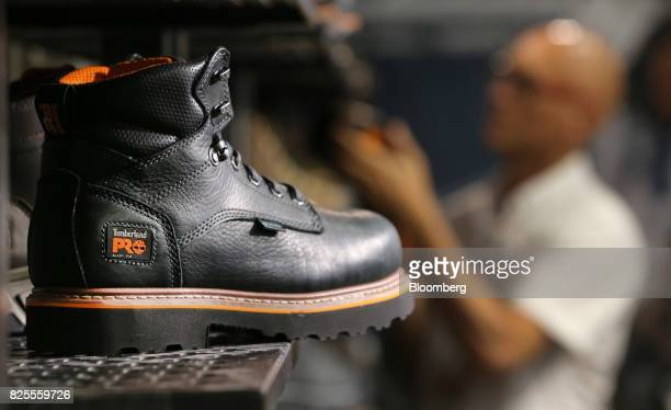 Timberland LLC boots sit on display during the Outdoor Retailer Summer Market Show in Salt Lake City Utah US on Saturday July 29 2017 Bloomberg is...