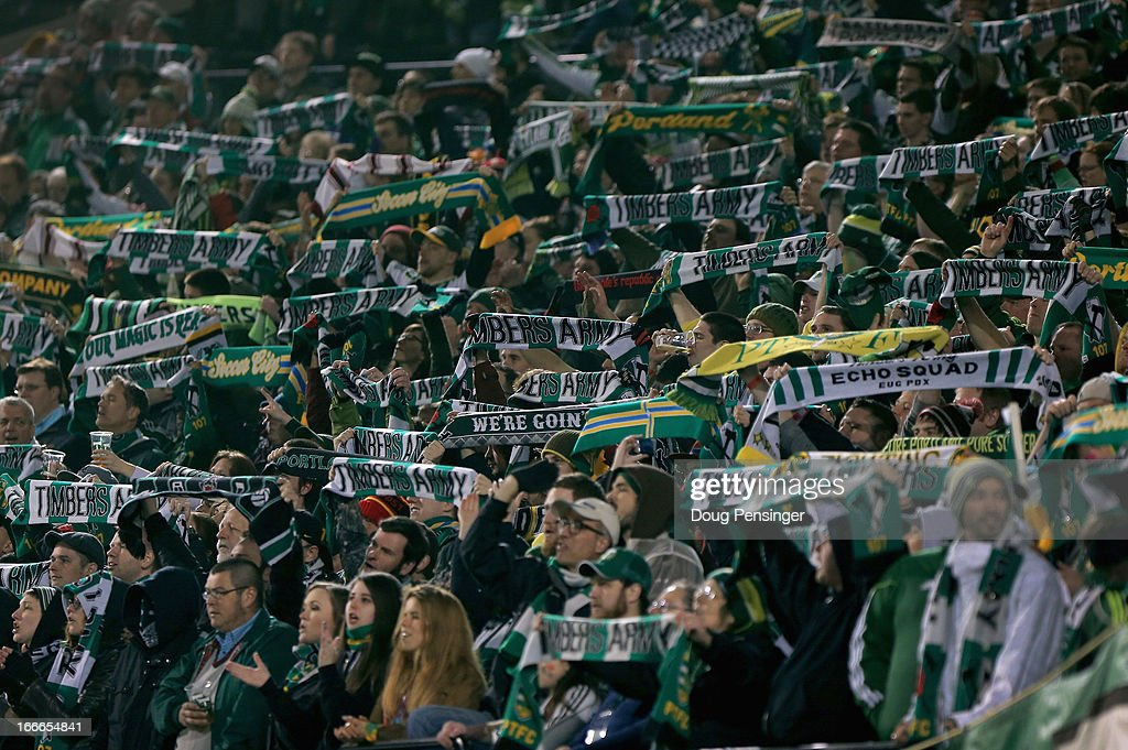 Timbers Army fans display their scarves as they support the Portland Timbers as they face the San Jose Earthquakes at JELD-WEN Field on April 14, 2013 in Portland, Oregon. The Timbers defeated the Earthquakes 1-0.