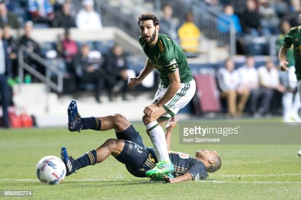Timbers Midfielder Diego Valeri watches his shot defended by Union Defender Fabinho in the first half during the game between the Portland Timbers...