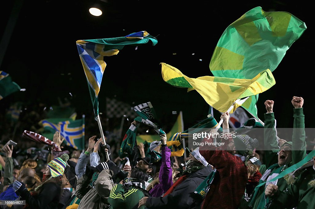 Timbers supporters wave flags as they celebrate the game winning goal by Will Johnson of the Portland Timbers against the San Jose Earthquakes in the...