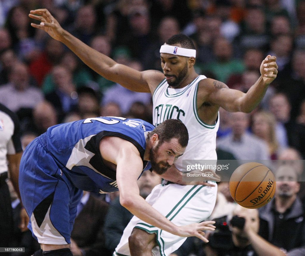 Timberwolves forward Kevin Love (#42) turns over the ball while being guarded by Celtics F Chris Wilcox (#44) in the 1st quarter as the Boston Celtics play the Minnesota Timberwolves during a regular season NBA game at the TD Garden in Boston, Mass. on Wednesday, Dec. 5, 2012.