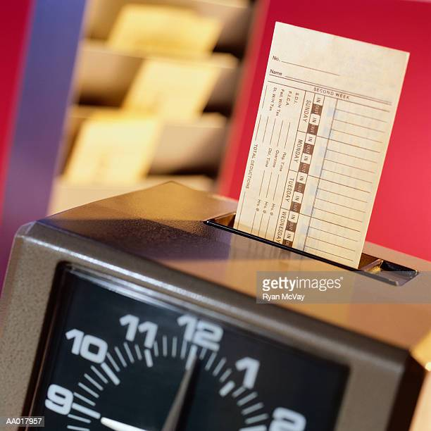 Time Clock Marking a Time Card