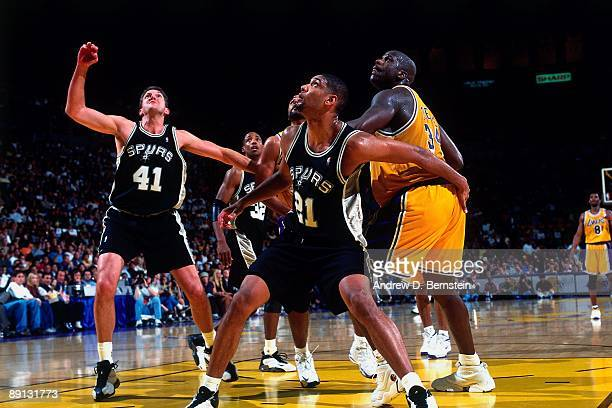 Time Duncan of the San Antonio Spurs boxes out Shaquille O'Neal of the Los Angeles Lakers in Game Four of the Western Conference Semifinals during...