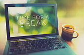 Coffee break at morning concept with laptop serene morning vintage editing style