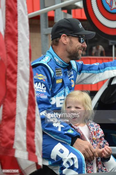 Time for a nap as daughter of Matt Kenseth rides along with him for fan introductions at the NASCAR Monster Energy Cup Series Auto Club 400 on March...