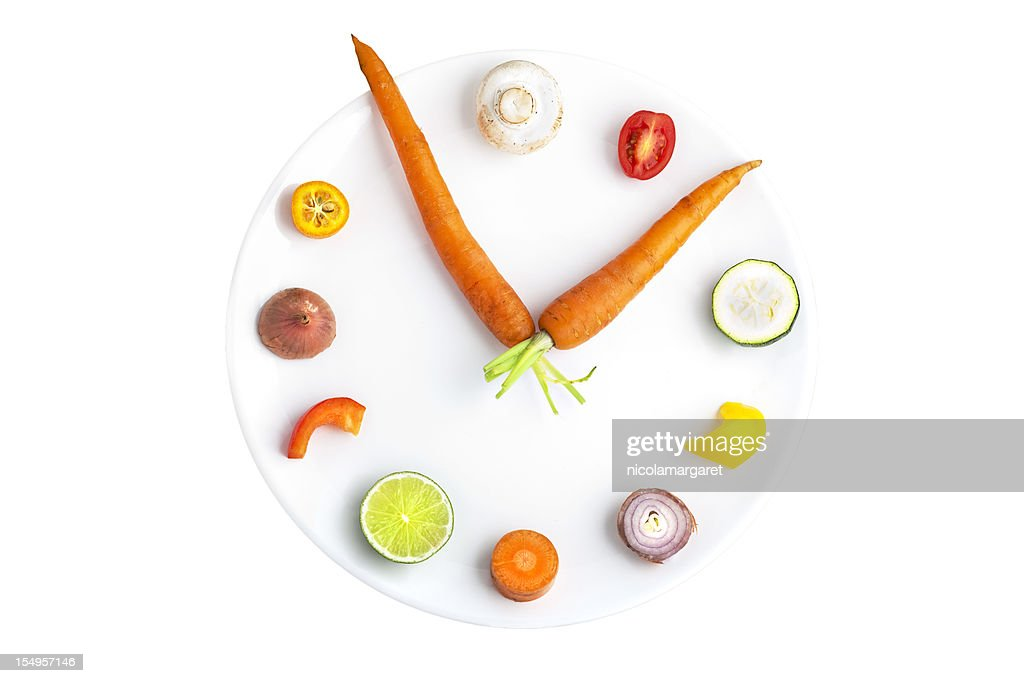 Time for food - clock made from assorted fruit & vegetables : Stock Photo
