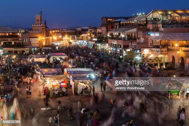 Time lapse view of illuminated buildings and city market, Marrakech, Morocco