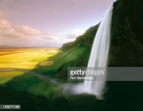 Time lapse view of waterfall over cliff : Stock Photo