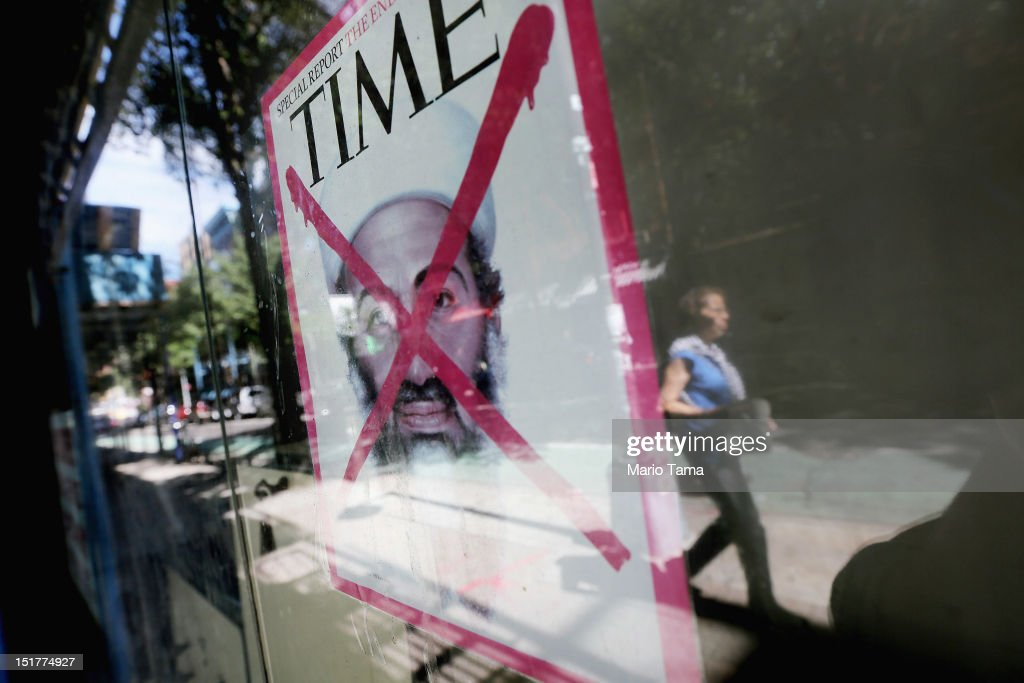 A Time magazine cover depicting Osama bin Laden after his death is taped to a Lower East Side storefront window on the eleventh anniversary of the terrorist attacks on lower Manhattan at the World Trade Center on September 11, 2012 in New York City. New York City and the nation are commemorating the eleventh anniversary of the September 11, 2001 attacks which resulted in the deaths of nearly 3,000 people after two hijacked planes crashed into the World Trade Center, one into the Pentagon in Arlington, Virginia and one crash landed in Shanksville, Pennsylvania.