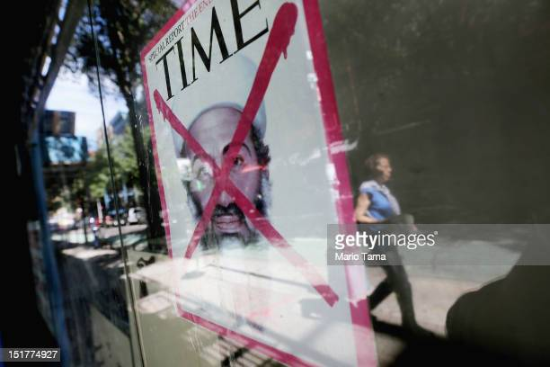 Time magazine cover depicting Osama bin Laden after his death is taped to a Lower East Side storefront window on the eleventh anniversary of the...