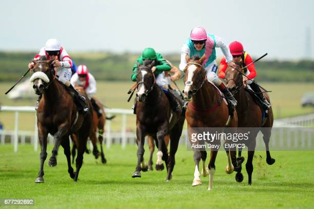 Time piece ridden by Tom Queally comes through to win the Ethihad Airways Falmouth Stakes